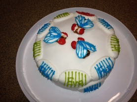 Drosophila cake, complete with embryos around the edge.