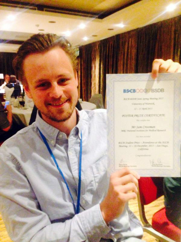 PhD poster prize winner Sam Crossman celebrating with his poster.